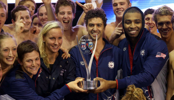 GLASGOW, SCOTLAND - DECEMBER 21: Team USA's Anthony Ervin (C), Jessica Hardy (L) and Cullen Jones (R) pose with the trophy after victory during Day Two of Duel In The Pool at Tollcross International Swimming Centre on December 21, 2013 in Glasgow, Scotland. (Photo by Ian MacNicol/Getty Images)
