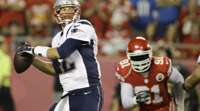 New England Patriots Quarterback Tom Brady, Left, Throws As Kansas City Chiefs Linebacker Tamba Hali, Right, Defends During The First Quarter Of An NFL Football Game Monday, Sept. 29, 2014, In Kansas City, Mo. (AP Photo/Nati Harnik)