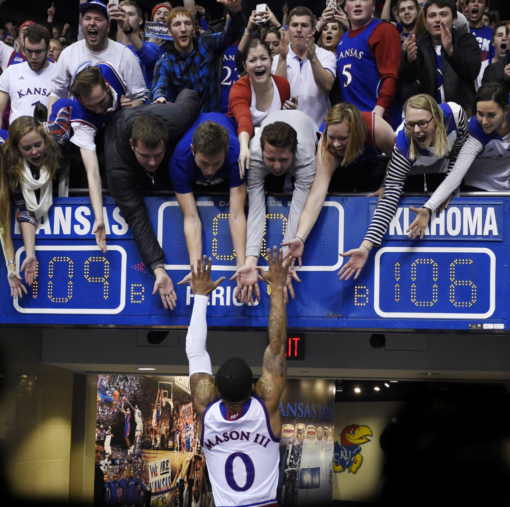 KU's Frank Mason jumps into the arms of his classmates after the Jayhawks beat Oklahoma 109-106 in triple overtime Monday night, Jan. 4, 2016, at Allen Fieldhouse in Lawrence, Kan. (Rich Sugg/Kansas City Star/TNS)