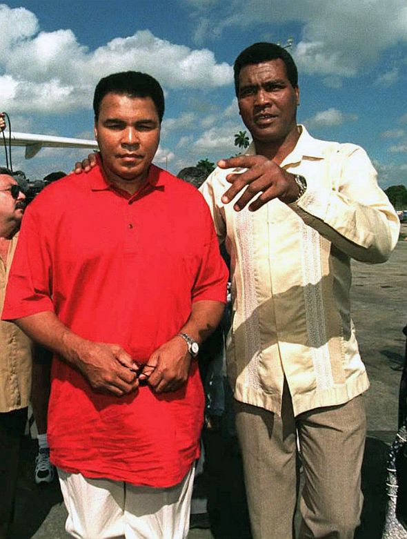 Former Cuban boxer Teofilo Stevenson (R), a three-time world amateur boxing champion, greets former world heavyweight champion US Muhammad Ali (L) on 18 January upon his arrival at the Jose Marti International Airport in Havana, Cuba. Stevenson --who won 301 of the 321 fights he took part-- died of a heart attack at the age of 60 in Havana on June 11, 2012.    AFP PHOTO