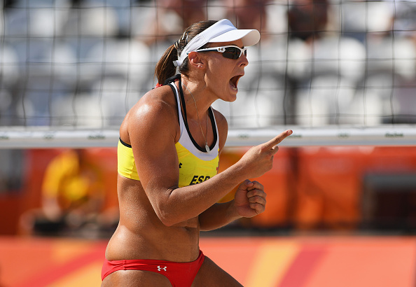 RIO DE JANEIRO, BRAZIL - AUGUST 06: Liliana Fernandez Steiner of Spain celebrates during the Women's Beach Volleyball preliminary round Pool B match against Georgina Klug (2) and Ana Gallay of Argentina on Day 1 of the Rio 2016 Olympic Games at the Beach Volleyball Arena on August 6, 2016 in Rio de Janeiro, Brazil. (Photo by Shaun Botterill/Getty Images)