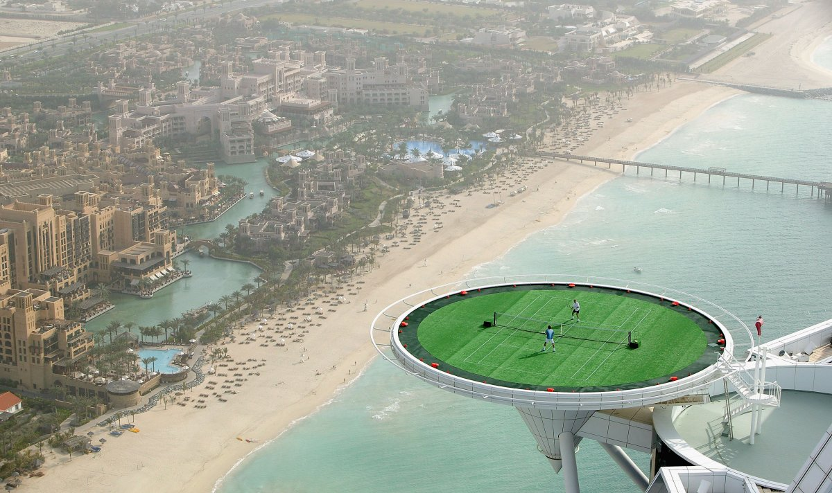 one-of-the-hotels-main-features-is-its-heliport-it-can-be-converted-into-a-grass-tennis-court-that-hanging-off-the-side-of-the-hotel-650-feet-up-is-the-highest-suspended-tennis-court-in-the